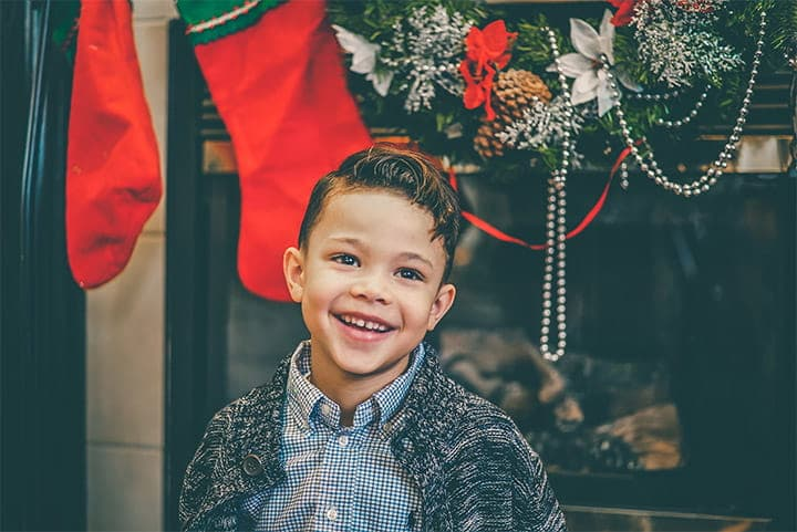 Boy At Christmas With Stockings